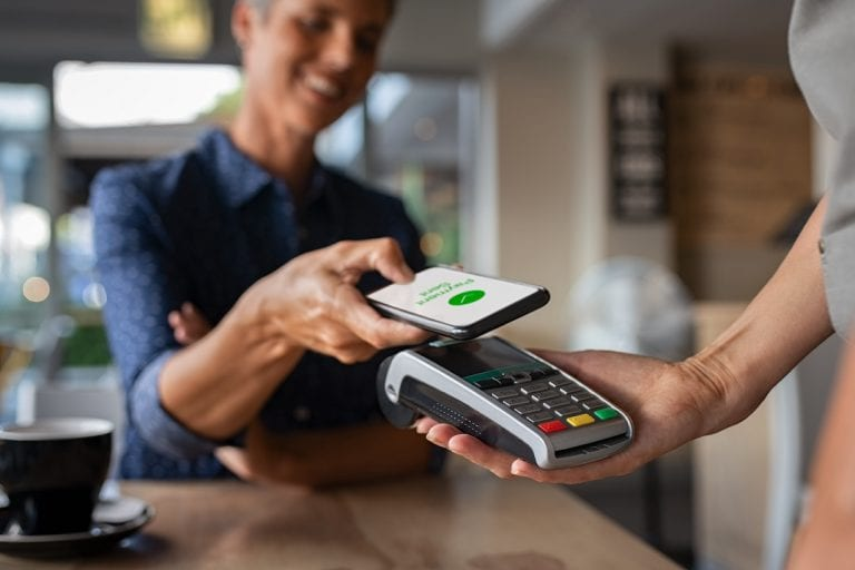 Woman,Paying,Bill,Through,Smartphone,Using,Nfc,Technology,In,A